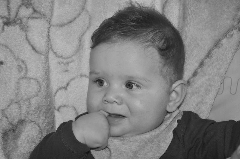 Close-up of cute baby boy at home