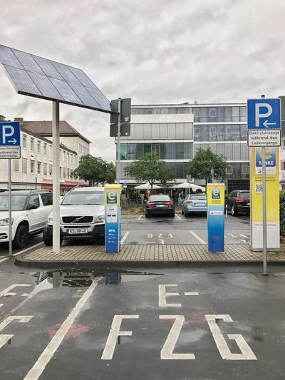 Environmentally Friendly Solar Energy Economy Plug Electro Car Power Electricity  Battery Transfer Charge New Technology Parking Sign Energy Charging Station Electro Station Car Load Battery Fill Station Refill Upload Parking Transportation Driving Investing In Quality Of Life Paint The Town Yellow