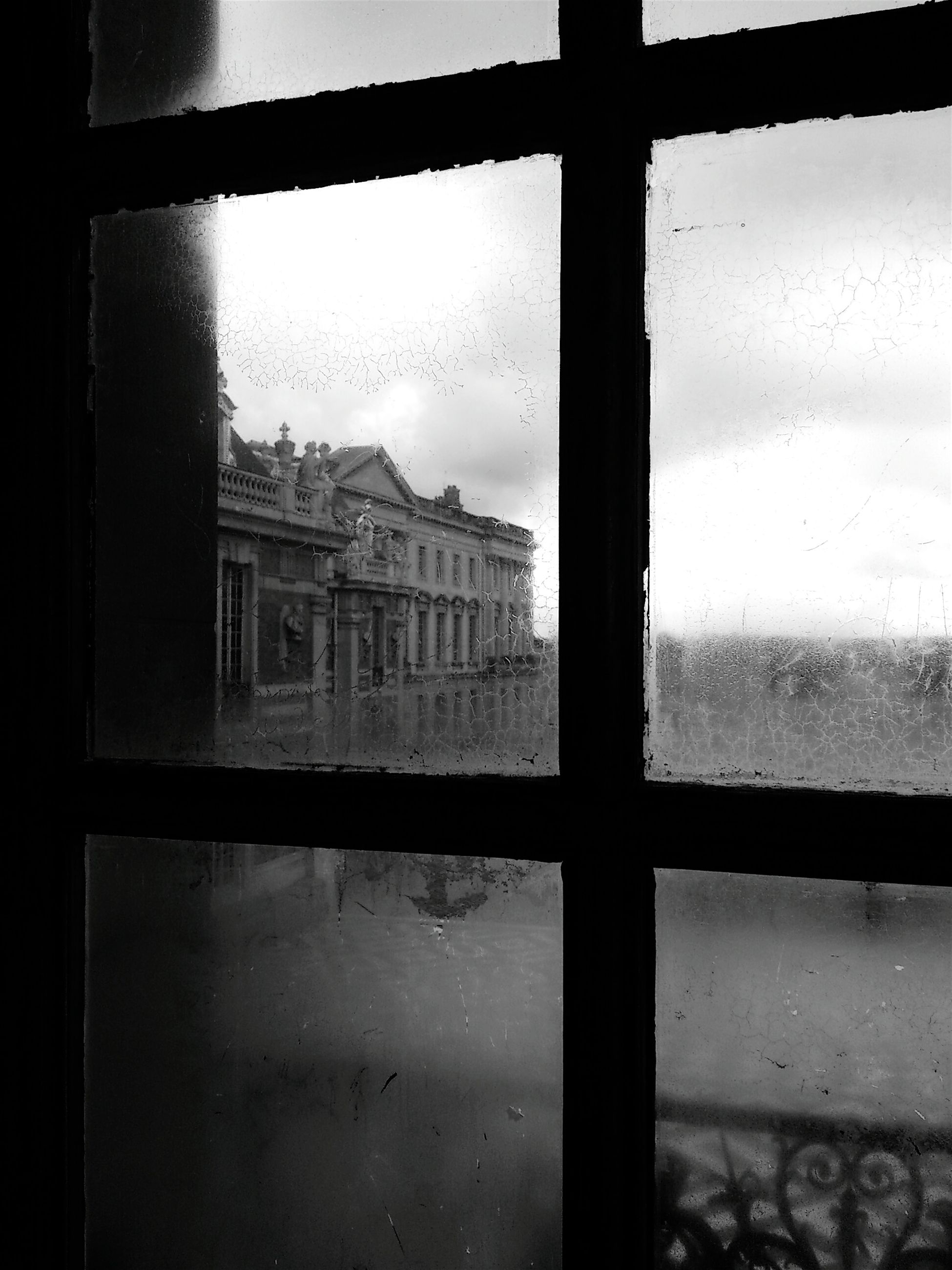 window, architecture, indoors, glass - material, built structure, transparent, building exterior, sky, glass, day, abandoned, old, closed, no people, cloud - sky, reflection, building, weather, house, window frame