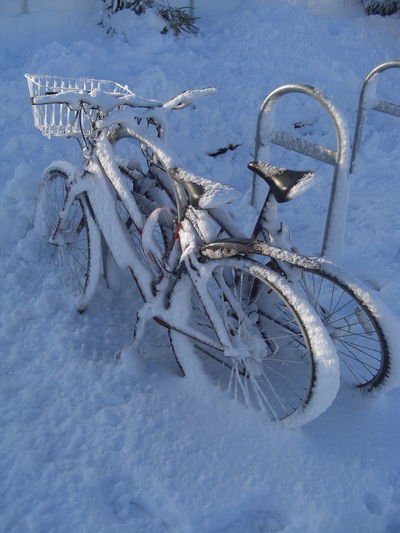 High angle view of bicycles on snow covered field