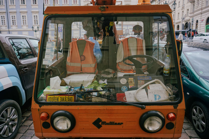 Men At Work  Orange Prague Working Architecture Builders Building Exterior Car City Culture Day Land Vehicle Lifestyles Mode Of Transport No People Outdoors Real People Transportation