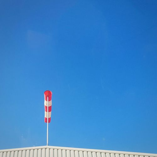 Windsock Against Clear Blue Sky