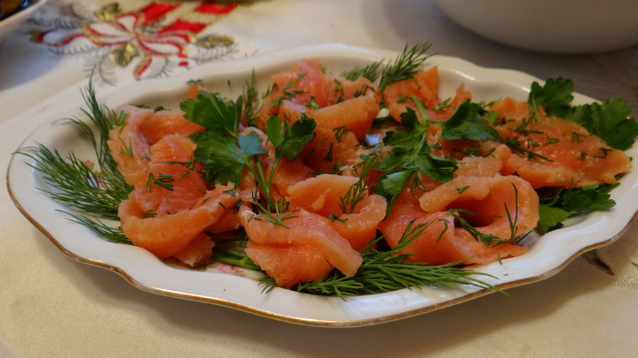 Close-Up Of Salad With Salmon In Plate On Table