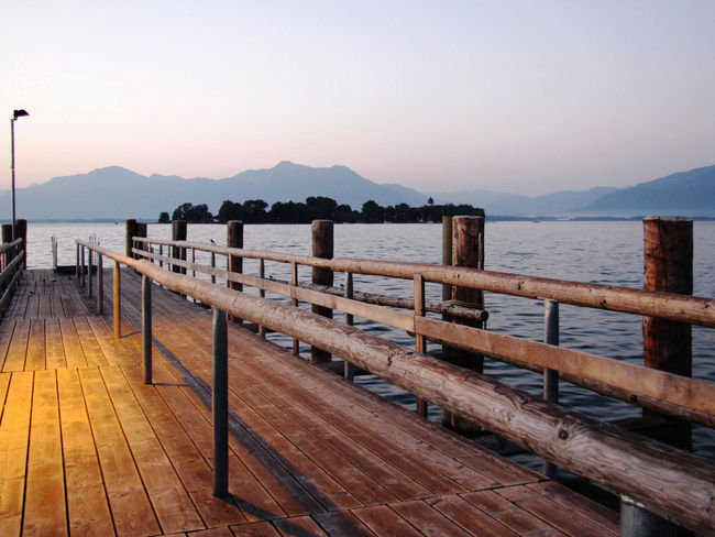 Hometown Funky Blues Series Calm Chiemsee Clear Sky Dusk Fraueninsel Idyllic Jetty Mountain Mountain Range Nature Non-urban Scene Ocean Pier Railing Scenics Sea The Way Forward Tourism Tranquil Scene Tranquility Travel Destinations Vacations Water Waterfront