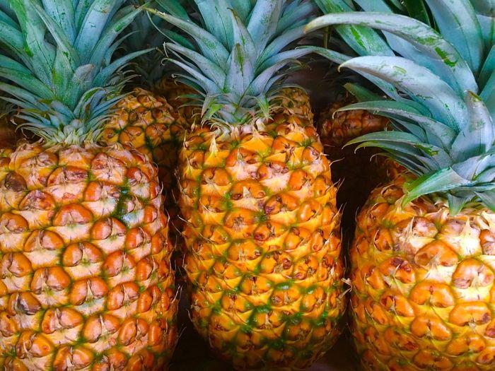 Full frame shot of pineapples