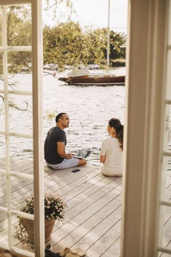 People sitting by window