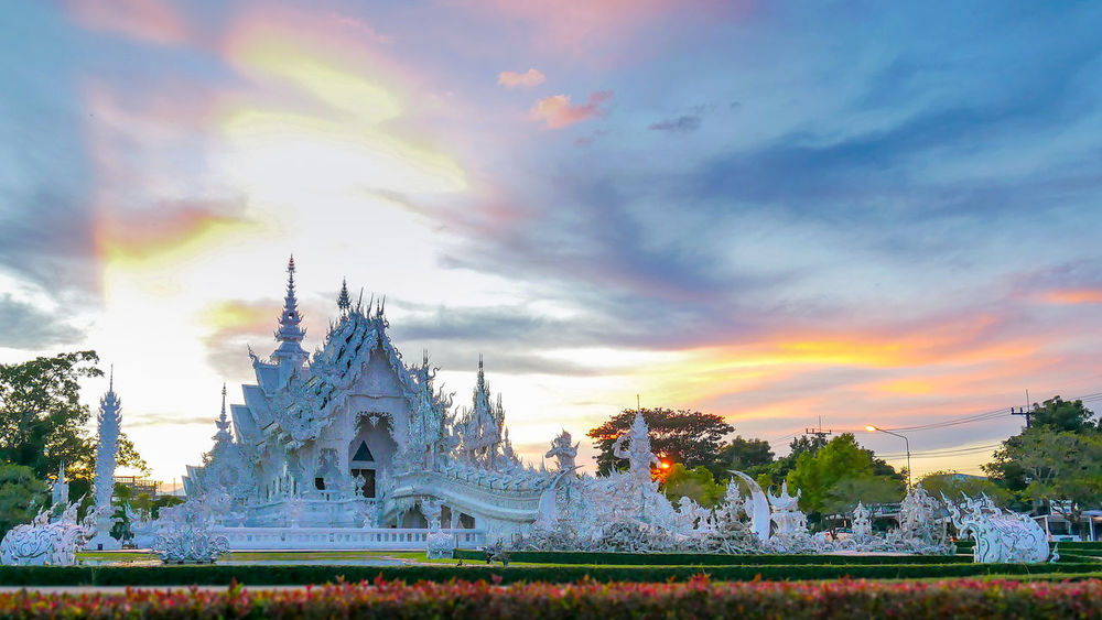 wat rong khun in Chiang Rai, Thailand Wat Rong Khun WatRongKhunWhiteTemple Architecture Building Exterior Built Structure Cloud - Sky Day Nature No People Outdoors Place Of Worship Religion Sky Spirituality Sunset Travel Destinations Tree