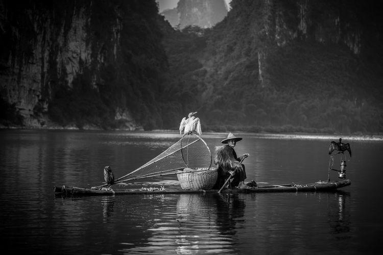 Portrait of senior man in fishing boat