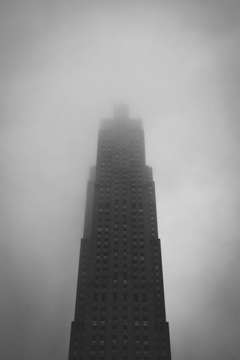 An office skyscraper rises into the foggy sky in Manhattan, New York City, New York, USA. Architecture Building Building Exterior Built Structure City City Life Foggy Foggy Day Low Angle View Manhattan Modern New York New York City No People Office Building Overcast Perspective Sky Skyscraper Tall - High Weather