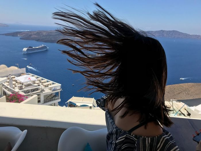 Wind! One Person Water Lifestyles Sea Nature Hair Architecture Long Hair Portrait Outdoors Women Real People Young Women Hairstyle Built Structure Adult Day