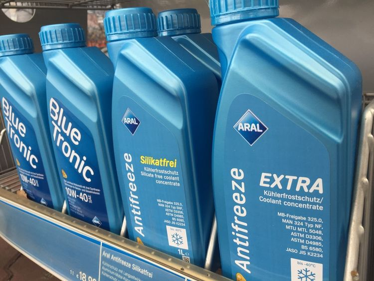 Berlin, Germany - March 26, 2018: Aral SuperTronic antifreeze coolant. Aral is a brand of automobile fuels and petrol stations, present in Germany and Luxembourg Cars Lubricants Antifreeze Bottle Car Close-up Coolant Engine Lubricant Lubrication Maintenance No People Performance Row Transportation Vehicle
