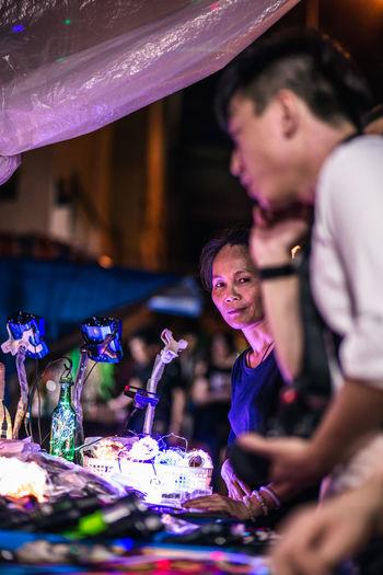 Street Vendor Night Market ASIA Market Vendor Night Lights Real People Street Streetphotography Street Photography Looking At Camera Hong Kong Lights The Street Photographer - 2018 EyeEm Awards The Photojournalist - 2018 EyeEm Awards