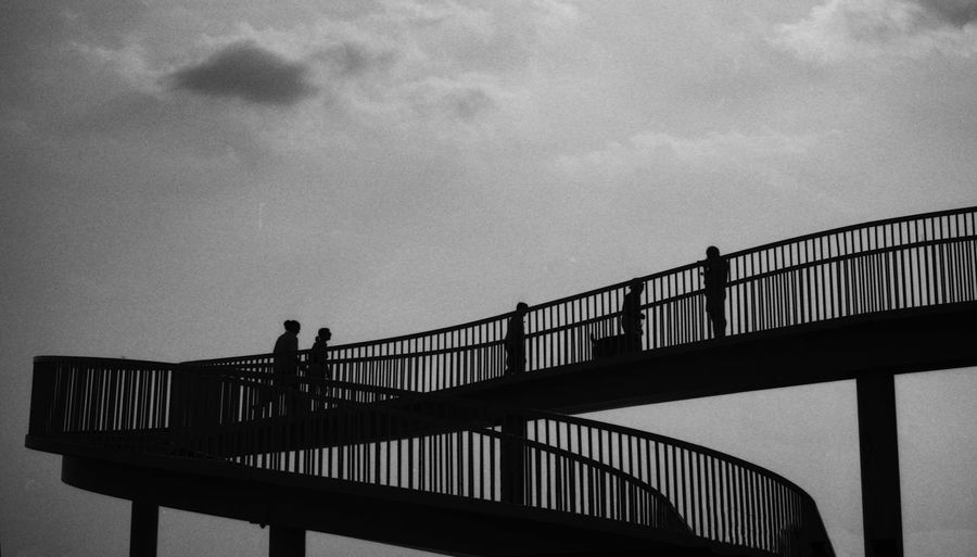 Low Angle View Of Silhouette Footbridge Against Sky