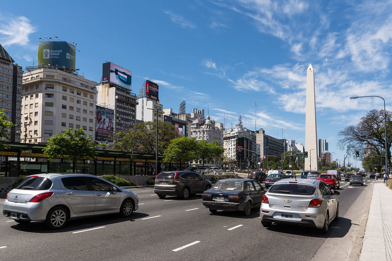 Buenos Aires, Argentina - October 30, 2016: Obelisk and Avenida 9 de Julio with traffic car in Buenos Aires in a sunny day 9 De Julio America Argentina Avenue Buenos Aires Building Building Exterior Capital Cars City City Life City Street Cityscape Cityscape Ciudad Autónoma De Buenos Aires Day Landmark Latin Monolith Monument Obelisc Obelisk Sky Street Urban
