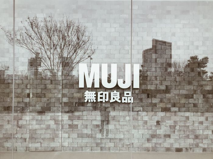 Information sign on wall in city