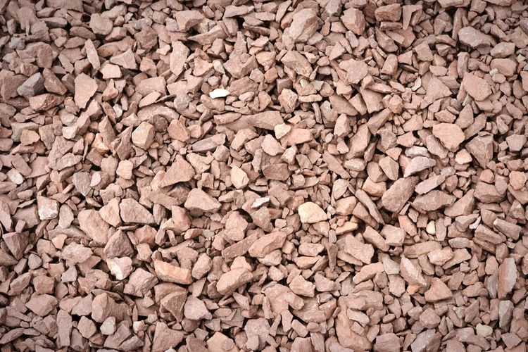 crushed porphyry stone, construction material. natural background Rocks Construction Quarry Pit Construction Material Bergbau Steinbruch Construction Materials Porphyry Rock Formation Full Frame Stones Steine Schottersteine
