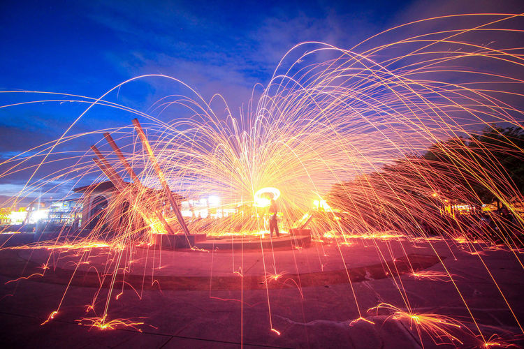 Steel Wools Spinning in the dawn hours. Sunset Steelwoolphotography Steel Wool Spinning Spinning Around Steel Sunrise Long Exposure Night Celebration Motion Sky Blurred Motion Firework Display Low Angle View Outdoors Illuminated No People Arts Culture And Entertainment Multi Colored Nature