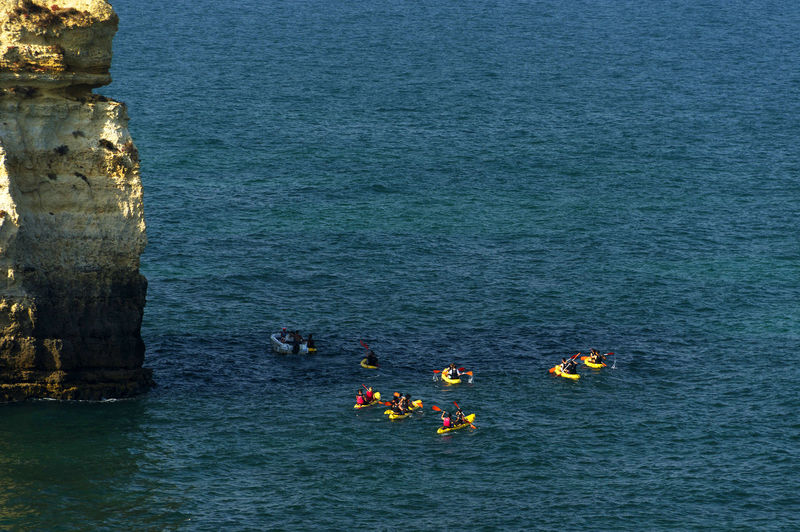High Angle View Of Canoeing In Calm Blue Sea