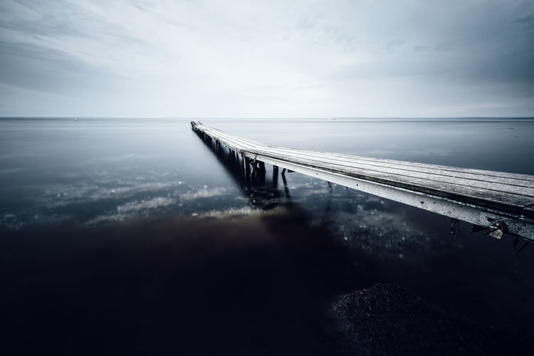 Horizon Sea Water Horizon Over Water Sky Scenics - Nature Tranquility Nature Cloud - Sky Tranquil Scene No People Beauty In Nature Day Long Exposure Outdoors Pier Reflection Wood - Material