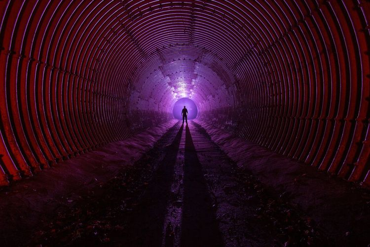 Silhouette People Night Adult Illuminated One Person Outdoors Galaxy Light And Shadow Atmospheric Mood Red Cold Space Tunnel Ribbed Wall Ribbed Purple Human Architecture Cinematic Photography Darkness And Light Man One Man Only Mist