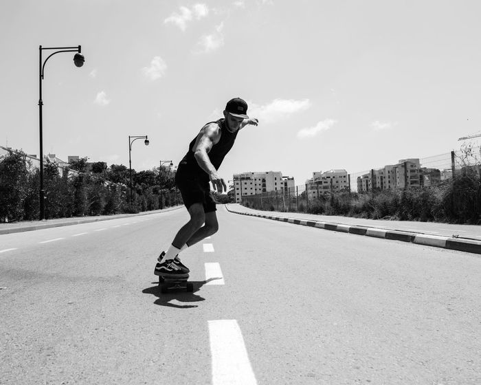 Down HiLl Lifestyles Full Length Motion Leisure Activity Transportation Jumping Skateboarding Mid-air Skill  Sport Enjoyment Casual Clothing Skateboard Balance RISK Road On The Move Shadow Architecture Riding People And Places Front View Skate Skateboarding Battle Of The Cities Welcome To Black