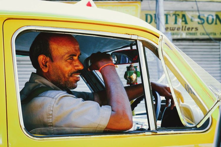 India Incredible India Taxi Portrait Car Transportation Men City Kolkata Colorful Yellow Urban The Week Of Eyeem Eye4photography  Check This Out ASIA Vscocam Streetphotography Documentary Travel Photography VSCO EyeEm Best Shots Colours Journey City