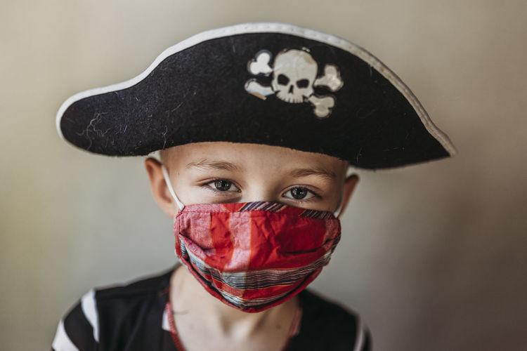 Close-up portrait of boy wearing hat