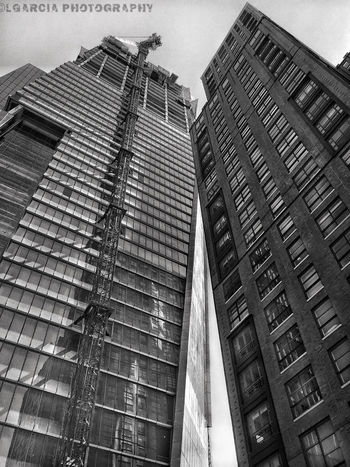 The view from below in monochrome. LGarciaPhotography Monochrome New York City Street Photography Architecture New York Iphonephotography The High Line IPhone Black And White