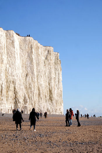 CliffEdge Beauty In Nature Clear Sky Cliff Day Domestic Animals Landscape Leisure Activity Lifestyles Livestock Mammal Medium Group Of People Mountain Nature Outdoors People Real People Rock - Object Scenics Seven Sisters Cliffs Seven Sisters Country Park Sky Togetherness Vacations Women