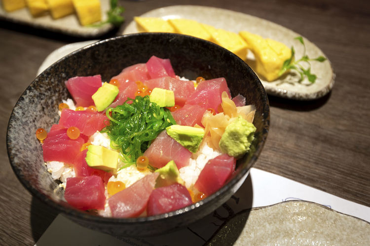 japanese Rice with Maguro Bowl Close-up Crockery Food Food And Drink Freshness Fruit Healthy Eating High Angle View Indoors  Japanese Food Meal Meat No People Onion Ready-to-eat Salad Serving Size Still Life Table Vegetable Wellbeing