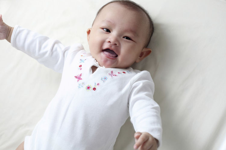 chinese baby Asian  Baby Care Innocence Adorable Baby Clothing Babyhood Child Childhood Chinese Cute Facial Expression Front View Healthy Infant Kid Lifestyles Little Lying Down One Person Portrait Real People Toddler  White Young