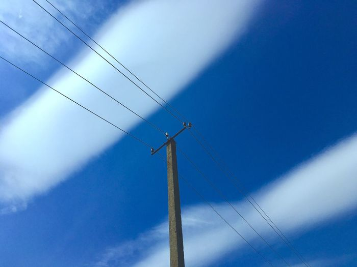 Blue Sky Low Angle View No People Cloud - Sky Nature Day Power Line  Sunlight Electricity  Power Supply Cable Outdoors Technology Connection Fuel And Power Generation