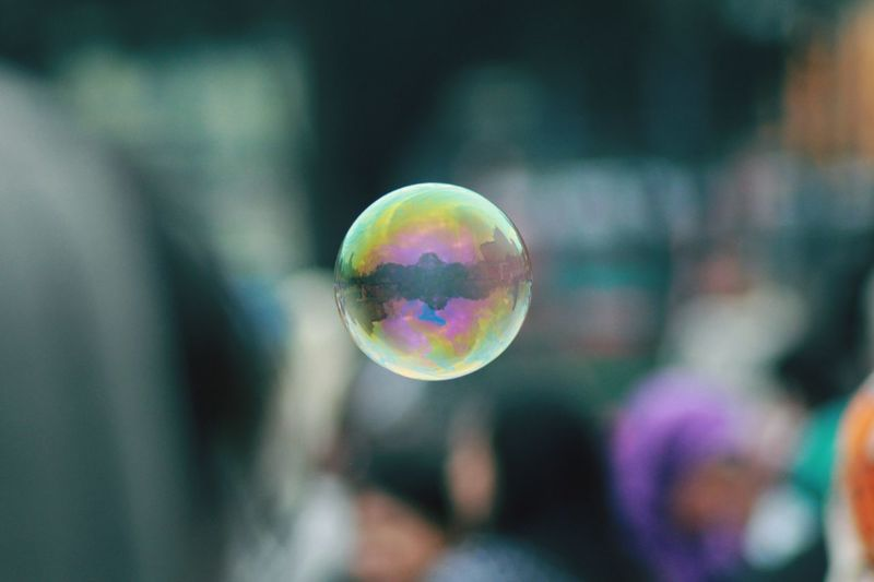 Close-up of bubble flying outdoors