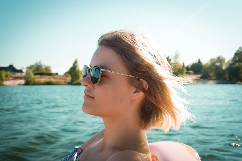 Blond Hair Clear Sky Close-up Day Focus On Foreground Headshot Lake Leisure Activity Lifestyles Nature Nautical Vessel One Person Outdoors Real People Sky Sunglasses Water Young Adult Young Women