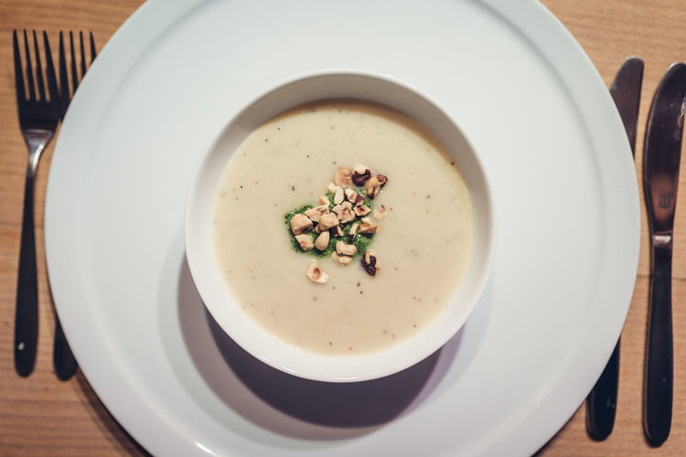Sunchoke (Jerusalem artichoke) soup with roasted peanuts in white bowl Food And Drink Food Wellbeing Table Healthy Eating Bowl Soup Directly Above High Angle View Serving Size Plate No People Close-up Vegetable Soup Dinner Sunchoke Peanuts Topinambur Jerusalem Artichoke