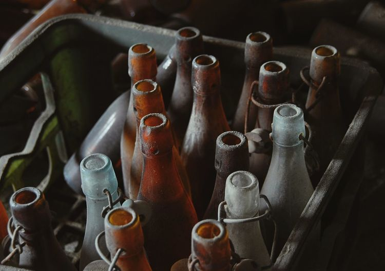 High angle view of empty beer bottles