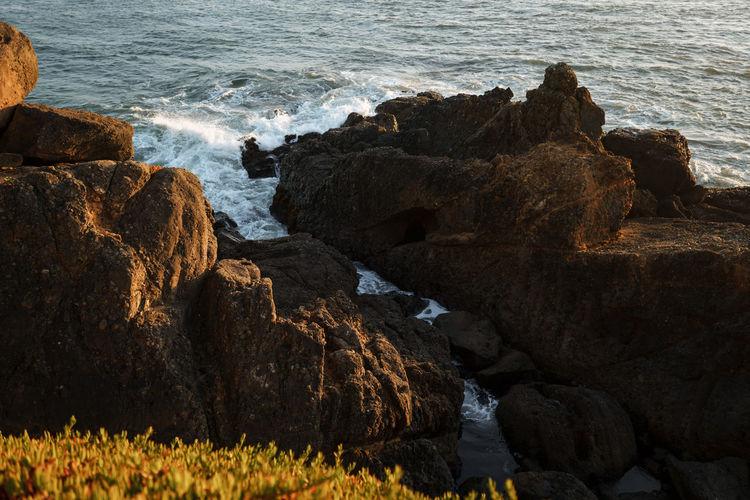 Rocks on shore by sea