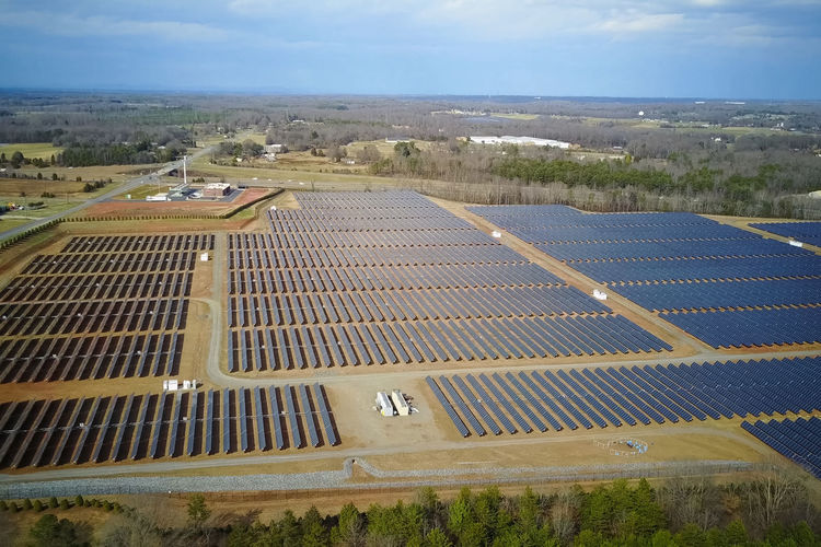 solar panels Environment Solar Energy Solar Panel Renewable Energy Alternative Energy High Angle View Landscape Sky Technology Environmental Conservation Nature Fuel And Power Generation Day Aerial View Outdoors Cloud - Sky Land No People Field Architecture Sustainable Resources Power Supply Solar Panels