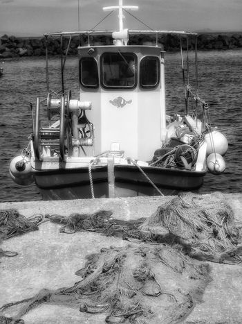 Fishing time Santorini Greece Greece Mode Of Transport Transportation No People Santorini, Greece Malephotographerofthemonth Hdr_captures Fujifilm Portrait_shots Black And White Boat Black And White Collection  Boats And Moorings MonochromePhotography Monochrome Photography Monochrome Photograhy Black And White Photography Landscape Photography Nautical Vessel Boats⛵️ Fishing Industry Fishingnets Black And White Collection!