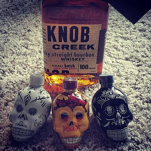 Awesome candy skull KAH Tequila bottles and some delicious Knob Creek Kah Tequila Knobcreek Bourbonwhiskey 100Proof Liquor TheSHITwindsAREblowing Alcohol Candyskull  Drinktography Dayofthedead Skulls Devil HandPainted Awesome Drink Drank Drunk
