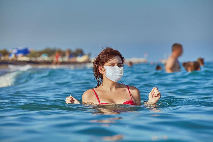 Portrait of woman wearing mask in sea