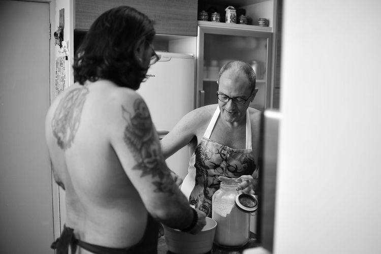 Men Preparing Food At Home
