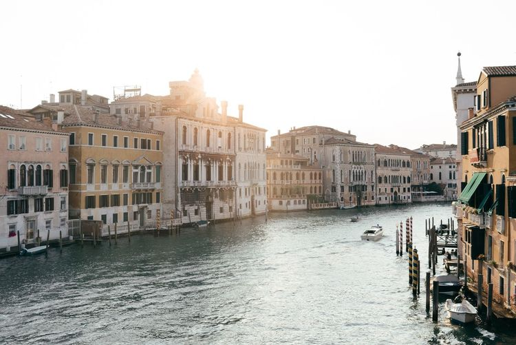 Boats Moored Along Canal In Venice