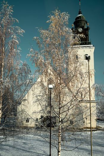 Tree Architecture Cold Temperature Winter Bare Tree Snow Religion Built Structure Day Branch Place Of Worship Building Exterior Tower Outdoors Nature Spirituality No People Low Angle View Sky Bell Tower EyeEmNewHere Church Architecture