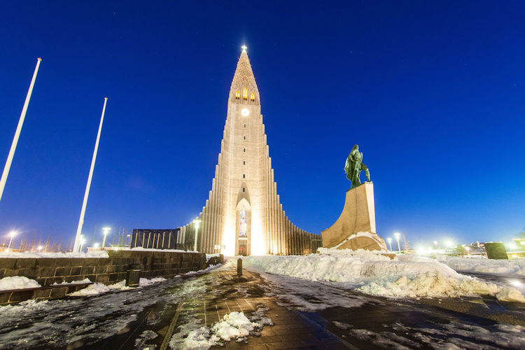 Hallgrimskirkja is a Lutheran parish church cathedral in Reykjavik, Iceland. Architecture Sky Built Structure Building Exterior Nature Travel Destinations Cold Temperature Snow Clear Sky Winter Hallgrìmskirkja HALLGRÍMSKIRKJA CHURCH Hallgrimskirkjachurch Hallgrimskirkja; Hallgrìmskirkja Lutheran Lutheran Church Illuminated Night Building No People Tower Blue Travel Outdoors City Spire