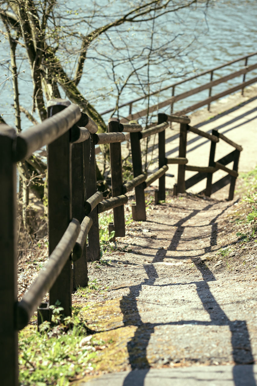 sunlight, shadow, tree, nature, day, plant, no people, boundary, outdoors, barrier, fence, wood - material, footpath, railing, security, safety, architecture, protection, metal, selective focus