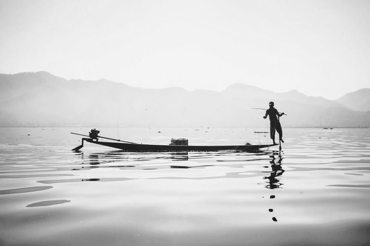 Mountain Water Real People Nature Outdoors One Person BYOPaper! The Great Outdoors - 2017 EyeEm Awards Mountain Range Fishing Net Inlay Lake Myanmar Eye4photography  EyeEm Gallery EyeEm Blackandwhite Scenics Lake Day Oar Standing Occupation Lifestyles Beauty In Nature Full Length