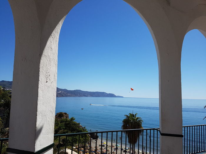 Water Sea Blue Arch Built Structure Scenics Calm Clear Sky Tranquil Scene Tranquility Ocean Seascape Nerja Coast Coastline Nerja Andalucia Nerja Spain Beach Holiday Shore Horizon Over Water Travel Destinations Vacations Outdoors Waterfront High Angle View SPAIN