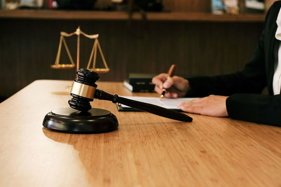 Adult Authority Business Business Person Courthouse Desk Focus On Foreground Hand Human Body Part Human Hand Indoors  Justice - Concept Law Lawyer Legal System Legal Trial One Person Table Wood - Material