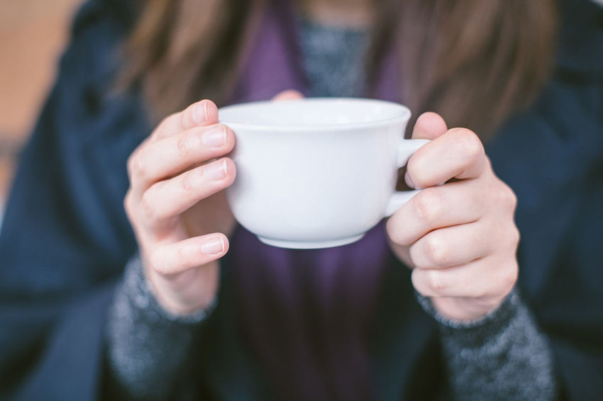 A girl drinking tea Close-up Coffee - Drink Coffee Cup Drink Drinking Female Fingers Food And Drink Freshness Front View Holding Human Hand Refreshment Tea - Hot Drink Tea Cup Warm Clothing White Cup
